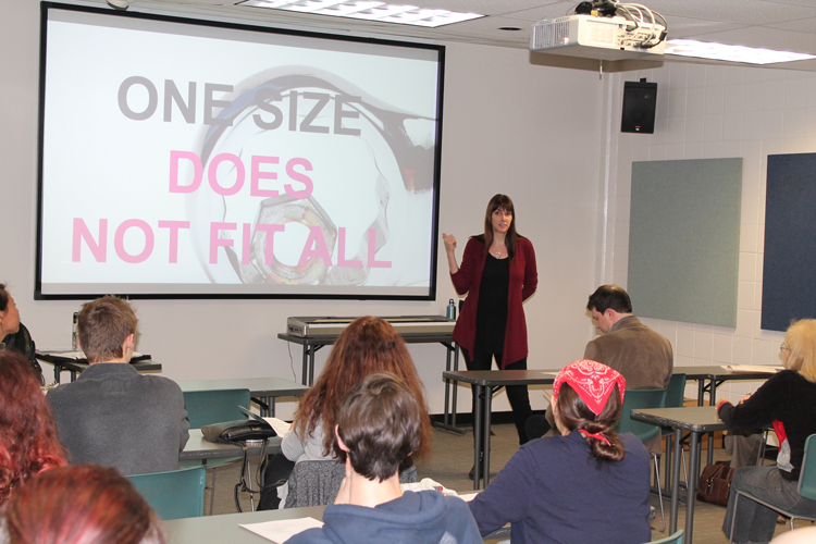 "Presenter in front of slide stating ""One Size Does Not Fit All"""